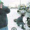 1/11/96-- weather--Takaaki Iwabu photo-- Dick Laurri of Lewiston shields his ears from cold wind as he waits for his flat tire fixed by Anthony Sansalone of Nick's Sunoco. (Area's bad weather gave troubles to many drivers Saturday)<br /> <br /> 1A, Sunday
