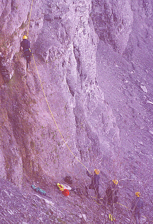 5/17/97-- rescue 1 --Takaaki Iwabu photo-- A NF firefighter climbs up the cliff with a rope as he goes up his way to the point where three teens stucked Saturday night. <br /> <br /> 1A, Sunday