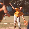 7/16/97-- little league --Takaaki Iwabu photo--Kenny Piotrowski of Lane Funeral Home Pirates pitches against Jocoy's Collision A's at LaSalle Majors Championship game Wednesday at Jayne Park. <br /> <br /> sports, Thurday