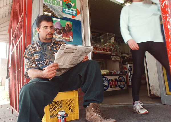 5/28/97 afternoon reading --Takaaki Iwabu photo -- Sanad Omar, owner of Niagara Deli, sits in front of his store reading newspaper Wednesday on 10th and Niagara Street.