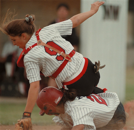 98/05/08-- softball --Takaaki Iwabu photo-- North Tonawanda Priscilla Martinez slides into the home base as Niagara-Wheatfield catcher Christine Hinderliter tries to block her during the Friday's game.  Martinez was safe and N-T won the game.