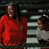 98/04/28-- track meet --Takaaki Iwabu photo--Sabrina Jones, left, teacher at Niagara Falls High School, and a 7-th grader Tamarah Smith cheer their school's athletes during track and field meet against Kenmore West Tuesday. <br /> <br /> grapevine photo