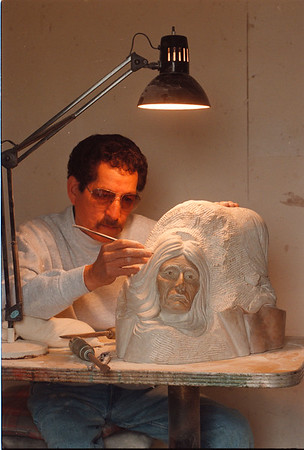 "5/29/97 Joseph Jacobs - James Neiss Photo - Joseph Jacobs a Master Native American Artist,  works on a Sculpture called ""The Mother of Nations"" carved out of ""Steatite"" Soapstone."