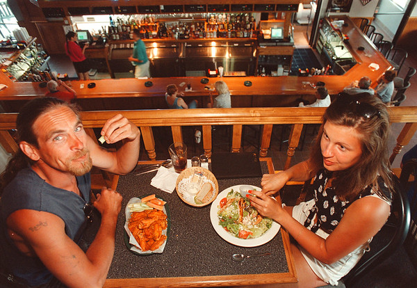 "6/10/97-- JT Wheatfields--Takaaki Iwabu photo-- Randy Nestark and Ronda Steves of Tonawanda enjoy dining at J.T. Wheatfields on Niagara Falls Blvd. Tuesday. ""They got very nice atmosphere,"" said Nestark about this newly opened restaurant in Wheatfield. <br /> <br /> local, Wednesday, bw"