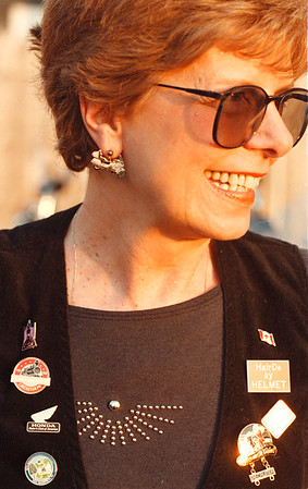 6/22/97--W bikers 3--Takaaki Iwabu photo-- Marge Dorato wears a pair of bike earrings and many badges on vest. (Dorato is a local school teacher and featured in Juddy's story)