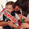 8/17/97--ITALIAN FESTIVAL--DAN CAPPELLAZZO PHOTO--9-MONTH OLD DOMINIC GUALANO COLLECTS HIS AWARDS, WINNING THE BAMBINO (BABY) CATEGORY AT THE PINE AVE FEST, WHILE GETTING A HUG FROM HIS PROUD MOTHER KIM.<br /> <br /> 1A
