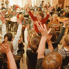 98/12/09 Newfane Rehab - Vino Wong Photo - Marie VanDette (middle) of Newfane Intermediate School leads a group of fourth graders during a Christmas chorus singing for seniors at the Newfane Rehabilitation and Health Care facility Wednesday.