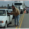 4/21/97 Tax Protest - James Neiss Photo - Native Americans and Supporters stopped traffic on Route 31 at Chew Roadd asking motorists to sign a petition and handed out informationl pamplets. Here,  Joan Kralick of Appleton signs a petition for Wendell Williams as others pass out information flyers.<br /> Tuscarora Indian Tax Protest Road Block Stop