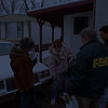 "98/01/27--CAYUGA/FIMA--DAN CAPPELLAZZO PHOTO--(LTOR) FIMA STAFFERS DEE FRANCKE, MIKE McGOWAN AND RICHARD HERNANDEZ SPEAK WITH CAYUGA ""C""STREET RESIDENT MELINDA SATTELBERG AS SHE SHOWS THEM HOW HIGH THE WATER LEVEL WAS DURING THE FLOODING.<br /> <br /> LOCAL"