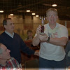 "98/02/06 Winterfest 4 * Dennis Stierer photo -  Ted ""The Devourer"" Werner, principal at Emmett Belknap school shows off his trophey for winning the pie eating contest for the third year in a row. Sen. George Maziarz was on hand to present the awards.  Looking on is Time Mulvey, of George Southard school and far right is Chris Abbott from the Kenan Center."