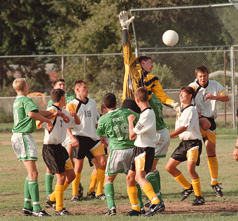 97/09/22--SOCCER COLOR--DAN CAPPELLAZZO PHOTO-- LASALLE GOALTENDER ERIC DEMLER GOES UP OVER TEAMSMATES AND LEWPORT FORWARDS AFTER A CORNER KICK IN THE FIRST HALF.<br /> <br /> SP