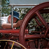 98/07/26 Olde Niagara day-Rachel Naber Photo-Dave Hall tinkers with a 6 horse power international harvester antique engine made in 1909 at  Olde Niagara Days at Niagara Fire company no.1 on Lockport Road.