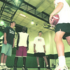 98/09/01--LEWPORT HIGH--DAN CAPPELLAZZO PHOTO--MOD. FOOTBALL COACH CHUCK MAHONEY (HOLDING FOOTBALL) SPEAKS TO (LTOR) 8TH GRADER ANDY TARNOWSKI, FRESHMAN RICKY POLK AND 8TH GR. NICK VALENTI IN THE REFURBISHED LEWPORT GYM.<br /> <br /> 1A