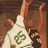 98/01/09-- HS basket 2--Takaaki Iwabu photo-- Lew-Port HS Jeff Moran blocks a shot from LaSalle's James Davis. <br /> <br /> sports, Saturday, bw