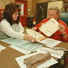 98/02/07--CAYUGA FLOOD--DAN CAPPELLAZZO PHOTO--SMALL BUSINESS ADMINISTRATION REP. VICKI NICASTRO GOES OVER PAPER WORK WITH HENRY MOUNTAIN, OF ELDERBERRY PLACE, CAYUGA VILLAGE APPLIES FOR A HOME REPAIR LOAN.<br /> <br /> LOCAL
