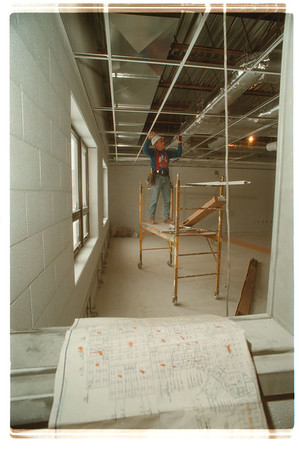 98/01/22 New Elementary  - James Neiss Photo - Ron Spaeth, a Carpenter, works on the suspended ceiling in the Computer lab of the new Niagara Wheatfield Elementary school.