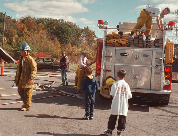 97/10/13-- open house--Takaaki Iwabu photo-- Fire fighters at Upper Mountain Fire Co. take care of their equipment after they came back from accident at Sunday's opening house. Demonstration to entertain children turned into a real emergency. <br /> <br /> tmc photo