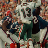 98/11/01--BILLS/MARINO SACK FUMB--DAN CAPPELLAZZO PHOTO--BILLS NT TED WASHINGTON KNOCKS THE BALL OUT OF THE HANDS OF DAN MARINO , IN THE 4TH QUARTER, AS BRUCE SMITH APPLIES PRESSURE. THE FUMBLE, RECOVERED BY PHIL HANSON, LED TO A STEVE CHRISTIE FIELDGOAL. BILLS 24 DOLPHINS 24.