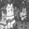 2/19/97-- power cats 2, bw --tak photo-- NF Jake Seright goes up for a basket.