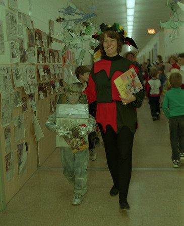 98/03/06 Costume Parade 2 * Dennis Stierer photo - Students at Thomas Marks Elementary school in Wilson dressed as their favorite storybook characters and marched around the school halls.  In this photo are (L-R) Bradley Pease, grade 2, with the principal, Karen Raccuia.
