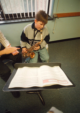 1/24/97 School Reportcard 5 - Nathan Witvoet 9/4th grade at LewPort North Middle School take a music lesson for Saxaphone.