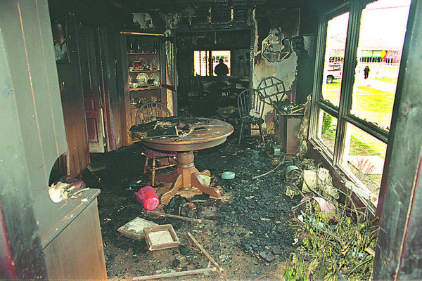 4/24/97--FIRE BOMBING/INTERIOR--DAN CAPPELLAZZO PHOTO--AN INSURANCE ADJUSTER GOES THROUGH THE FIRE BOMBED HOME OF TUSCAROROA CHIEF LEO HENRY.<br /> <br /> 1A NEWS