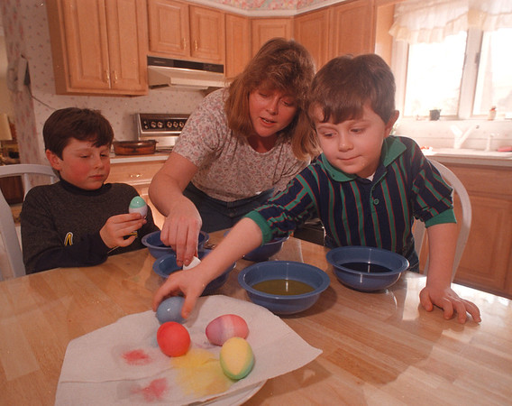 3/24/97 Easter Eggs - James Neiss Photo - L-R - Brian Basta 8yrs, Maureen Basta, Mom and Kevin Basta 4yrs, all Sue Campbells Neighbors, color Easter Eggs for Easter at their home next to Sue Campbells house who doesn't have Easter Eggs.