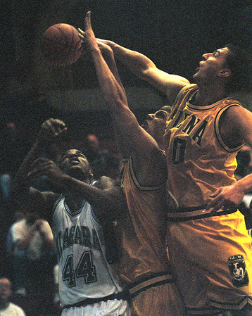 97/12/04--NU HOOPS--DAN CAPPELLAZZO PHOT0--NU CENTER KEVIN JOBITY IS STUFFED BY SIENA FORWARD JIM CANTAMESSA (RIGHT) AND CENTER DAVE DETERS IN FIRST HAFL ACTION.<br /> <br /> SP