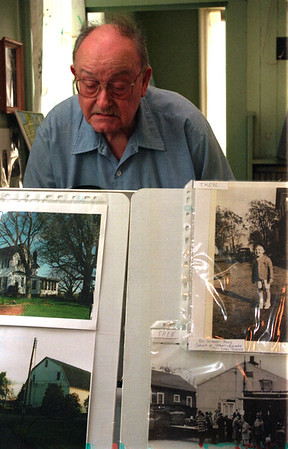 98/05/16 Historical-Rachel Naber Photo-Gordon Dietz came to the town of Lockport Historical Society Party to have  a look atthe towns history through pictures.