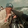 98/05/26--falcon --Takaaki Iwabu photo-- Bob Chambers of N.E.S.T. (Niagara Eagle Support Team) observe a female Pere Grine Falcon on the gorge near Niagara Falls Tuesday.<br /> <br /> 1a, Wednesday