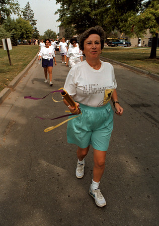 98/09/14 Womans Run - James Neiss Photo - Anna Spitzmesser, chairman of foreign languages at NU, leads the NU contingent off  campus for Woman Run New York.