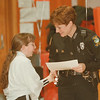 98/01/23 D.A.R.E. Grad - James Neiss Photo - Anne Attfield, DARE Officer Niagara Falls Police DPT. congratulates Ragina Battaglia 10yrs as she and other 5th graders at the Kalfas Magnet School, get their diplomas for passing a D.A.R.E. course.