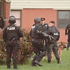 97/10/01--Drug Raid 1--Takaaki Iwabu photo-- NF police officers surrounded an apartment of 6D Packard Court during the drug raid in Wednesday morning.