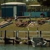 98/07/27 Fest Clean up - James Neiss Photo - Canal Fest Clean up continued today. Here workers hall off booth pieces.