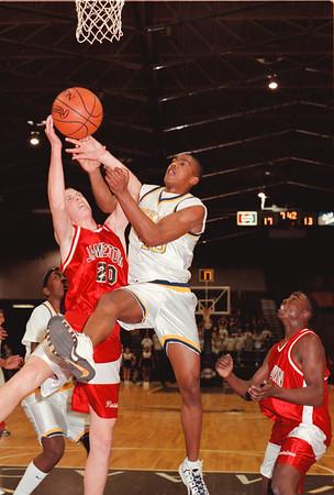 98/03/05 Lkpt vs Jamestown *Dennis Stierer Photo - Jason Chaffin #40, of Lockport battles Craig Swanson #20 of Jamestown for a rebound.