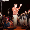 98/12/04 Newfane Party - Vino Wong Photo - Phillip Quinn conducts the Newfane High School jazz choir during the 12th Annual Christmas Tree Lighting at Petersen's Drugs store in Newfane Friday.