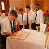 97/09/08--signing book--Takaaki Iwabu photo-- Students of St. Joseph's School sign the condolence books for Princes Diana and Mother Teresa at St. Joseph Church on Pine Ave. Monday.  Books will be placed at the entrance of the Church throughout this week and will be sent to England and India next Monday, said Phyllis Fasciano, who coordinated the event.   /Grapevine photo