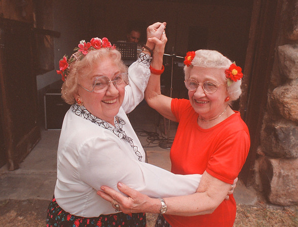 97/08/10 Polish Fest - James Neiss Photo - Sisters Doris Terry of B Street and Mary Jannotte of Grand Island cut the rug to the wacky polish sounds of Bregg Daoin, musician at the Echo Club Polish Festival.