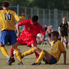 98/09/11 LHS Soccer2-Rachel Naber photo-Andrew Minderler (left) plays defense against Nick Minute of St. Francis and is assisted by Peter Sullivan (?)