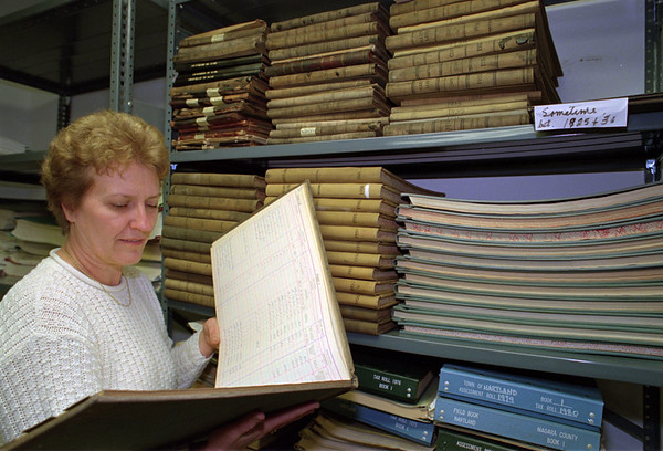98/12/11 Hartland Archives *Dennis Stierer Photo -<br /> Beverley Snell, Hartland Town Clerk looks over some old records in the Archive Room in the basement of the Town Hall, as she is also Records Management Officer.