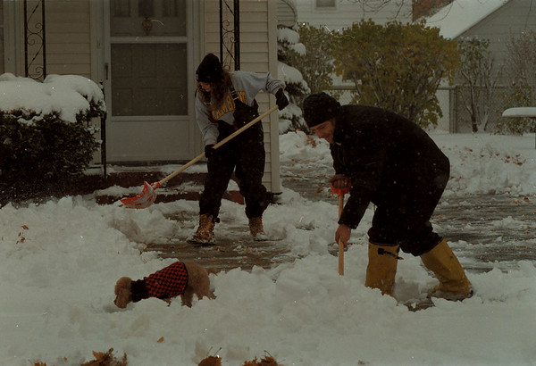 """97/11/14 Big Snow - James Neiss Photo - Tami Schmidt and Ken Walaszek, both of 69th street, were out shoveling their clients driveways and walks with their dog """"Macy"""".  The two entrepreneurs were seen cleaning up a walk in the 2700 block of South Ave this morning."""