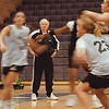 98/11/10 Coach Agronin - Vino Wong Photo - Coach Agronin watches his players practice on Tuesday.