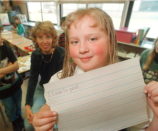4/18/97 Printing Champ - James Neiss Photo - Elizabeth Burkley 8yrs/2nd grade wone a state hand writing championship. Her 2nd grade teacher Vicki Fuerch looks on.<br /> Colonial Village School.