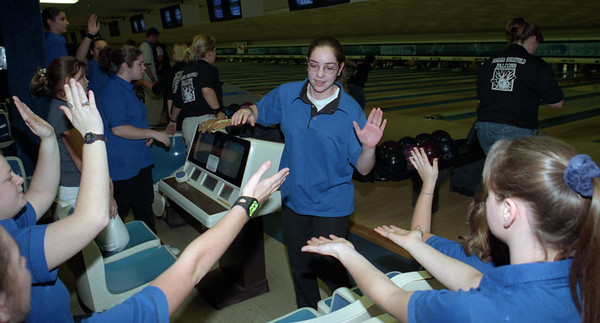 98/12/10 bowling--dan cappellazzo photo-- lkpt's sabrina sterling gets high five from teamates during a run in the first match at brandt lanes against wheafield.