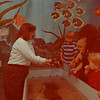 97/11/11--AQUARIUM TOUCH TANK--DAN CAPPELLAZZO PHOTO--AQUARUIM OF NIAGARA EDUCATION COORDINATOR JEANETTE BRUNNER SHOWS (LTOR) 6-YR-OLD ALEX OLSON, LEWISTON, 3-YR-OLD LYSLE HOOD, TORONTO, ASST. EDUCATION COOR. SUSAN MARCOLINI, AND 18 WEEK OLD MAXINE HOOD A LOBSTER FROM THE TOUCH TANK IN THE AQUARIUMS' EDUCATION CENTER.<br /> <br /> LOCAL
