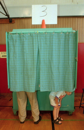 98/05/19 Starpoint School Vote - James Neiss Photo - 4yr old Alex Holler's  patience was all used up as he survays the world outside the voiting booth as his grandfather, Henry Orszulak,  makes his voting choices at Starpoint HS. Both live in Pendleton, NY.