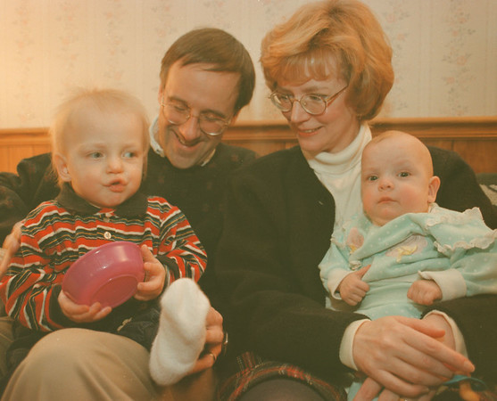 98/02/03--RUSSIAN BABIES--DAN CAPPELLAZZO PHOTO--STEVEN AND MARY ANN HAGENIAN HOLD THEIR ADOPTED RUSSIAN BABIES, (LTOR) 13 MONTH OLD GREGORY AND 11 MONTH OLD KATIE AT THE WEST SENECA HOME.<br /> <br /> FEATURE THURSDAY