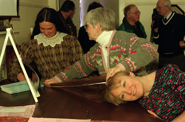 98/02/21 Measuring Hair *Dennis Stierer photo - Monica Bodkin from Youngstown is getting the length of her hair measured by Cindy Lewis(far left) and Betsy Diachun. Her hair measured 37 inches long. The event took place at the Niagara County Historical Society.