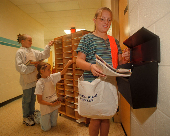 97/08/97 Errick Road Express - James Neiss Photo, Students to take on the delivery of in-school mail. Here, L-R, Alyssa Finiki, Erin Kaus and Jackie Bryant show how it's going to work as students handle it all, from sorting the mail to delivery.