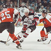 3/11/97-- Sabres 2 --tak photo-- Sabres Michal Grosek goes through the Flyers defense during the first period.